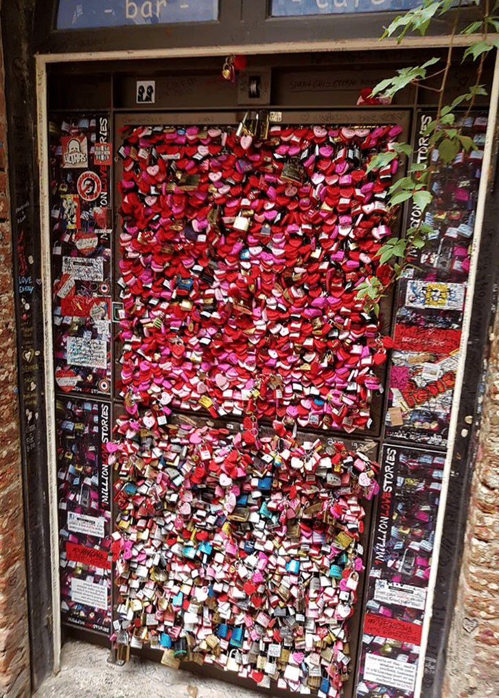 Girls from around the world come  to Verona in the hope for true love. They write notes for their future  Love and pin it on this wall.