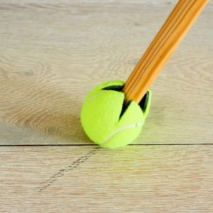 cleaning with tennis ball
